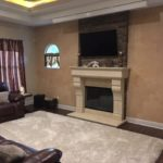 Custom stone fireplace in this media room addition